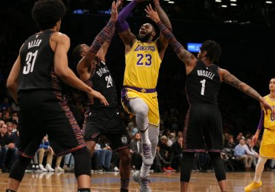 d7e8fbbd787 LeBron James s first game in New York wearing purple and gold had all the  fanfare of a big game even if the standings said otherwise.